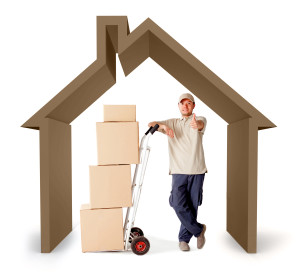 Moving services man with a 3D house - isolated over a white background