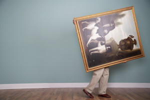 Man Carrying Large Painting --- Image by © Royalty-Free/Corbis