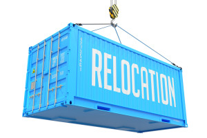 Relocation - Blue Cargo Container hoisted with hook Isolated on White Background.